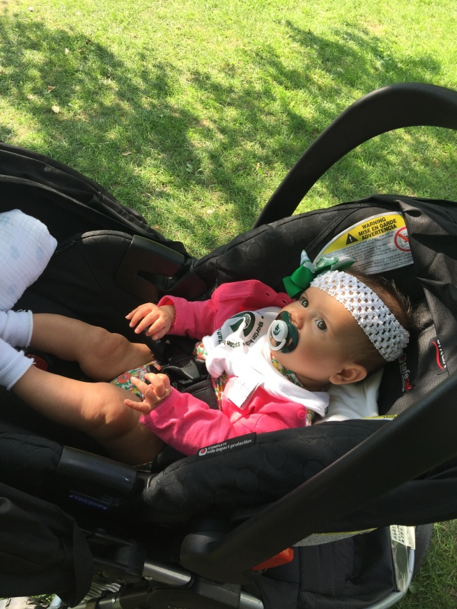 Return to undergrad alma mater: Chilling in her car seat by the Red Cedar River in East Lansing.