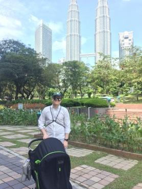 Strolling through the park around the Petronas Towers while Sophia naps